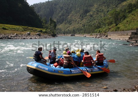 Whitewater Rafting on the Bhote Koshi in Nepal. The river has class 4-5 rapids. - stock photo
