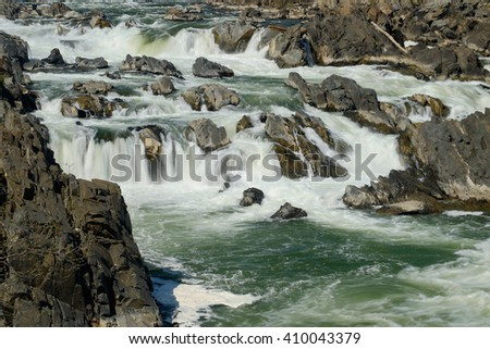 Whitewater Rapids and rocks of the Great Falls of the Potomac - stock photo