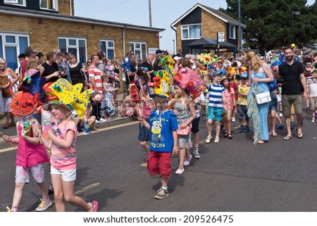 WHITSTABLE,UK-JULY 26: Adults, families and children with sea side theme costumes take part in the annual Whitstable Oyster Festival Parade watched by thousands of visitors. July 26 2014 Whitstable UK - stock photo