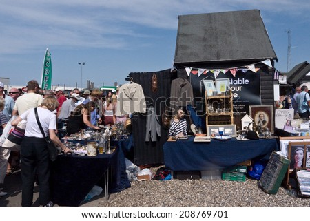 WHITSTABLE, UK-JULY 27: Hundreds of Stalls line the Harbour at Whitstable where thousands of visitors attend the annual Whitstable Oyster Festival. July 27, 2014 , Whitstable Kent UK. - stock photo