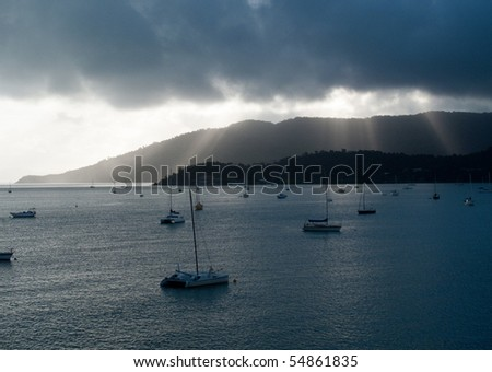 Whitsundays in Australia showing yachts at anchor in the bay - stock photo