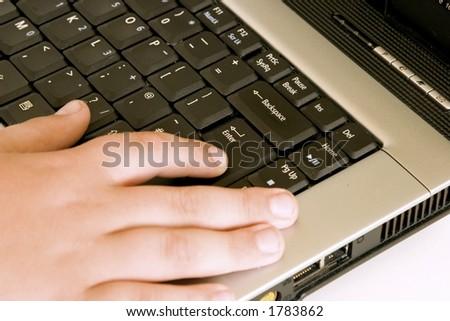 whizz kid on a laptop - stock photo
