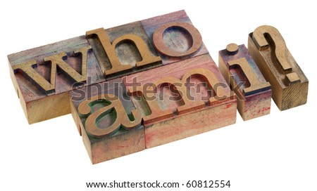 Who am I - a philosophical question spelled in vintage wooden letterpress printing blocks, isolated on white - stock photo