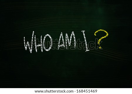Who am I Lettering, written with Chalk on Blackboard - stock photo