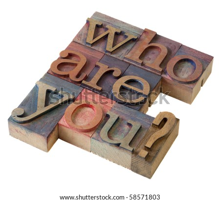 Who are you  question in vintage letterpress printing blocks, stained by color inks, isolated on white - stock photo