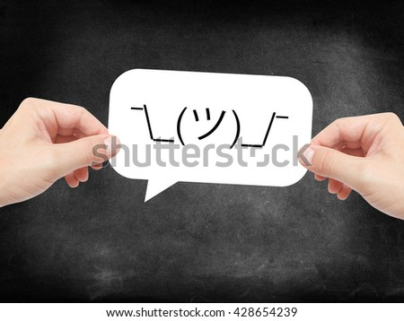 Who cares emoji written on a speechbubble - stock photo