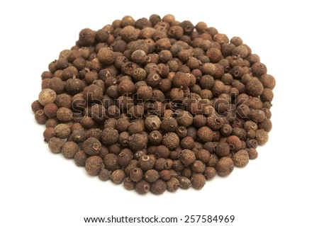 Whole allspice berries on a white background - stock photo