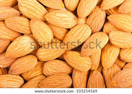 Whole almond nuts closeup, may be used as background
