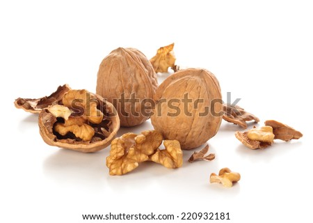 Whole and broken walnuts isolated on white background. - stock photo