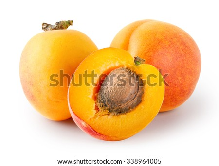 Whole and cut apricots with stones isolated on white background