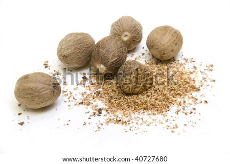 Whole and grated nutmeg isolated on white - stock photo