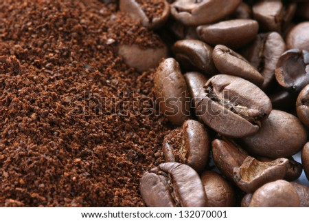 Whole and ground coffee beans scattered on white background - stock photo