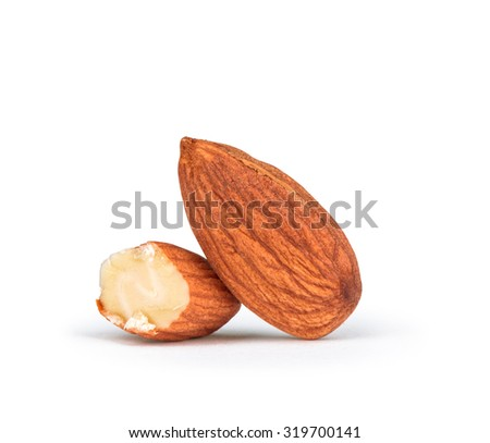 whole and half almonds isolated on white background - stock photo