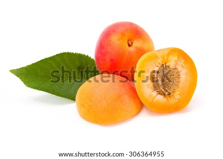 Whole and half apricots on white (Prunus armeniaca)