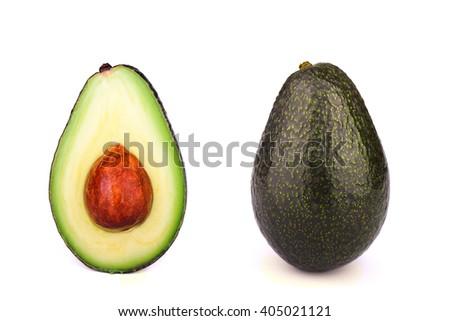 Whole and half avocado isolated on white background - stock photo