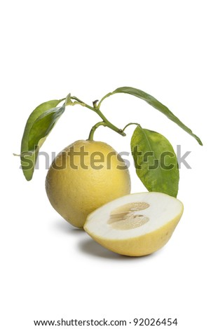 Whole and half Citrus Medica fruit on white background