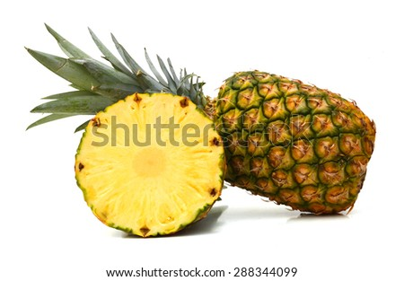 Whole and half ripe pineapple isolated on white - stock photo
