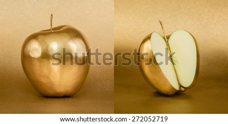 Whole and opened apple with golden peel on gold background - stock photo