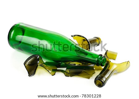 Whole and shattered green  bottle isolated on the white background - stock photo