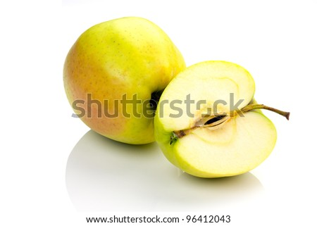 whole and sliced apples on a white background