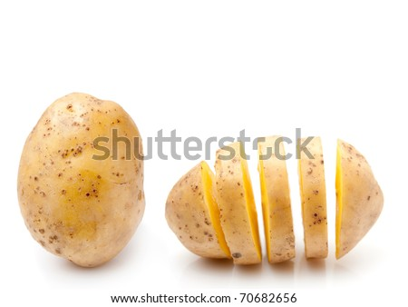 Whole and sliced potato on the white background