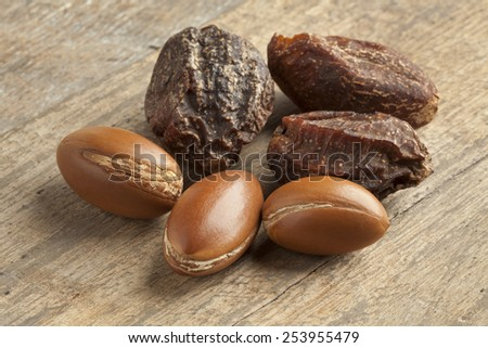 Whole Argan nuts and nutshells - stock photo