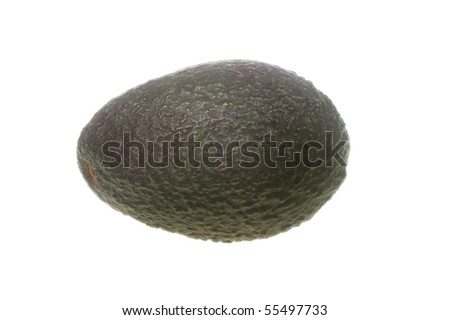 whole avocado black skin variety over white isolated