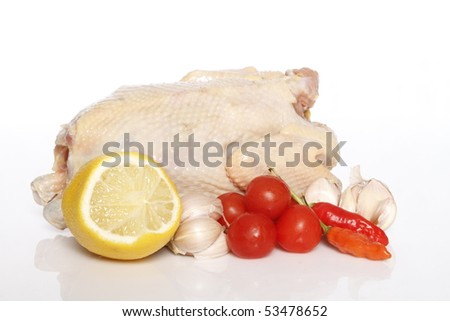 whole chicken raw and cooking ingredients - stock photo
