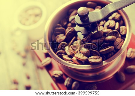Whole coffee beans in a coffee grinder. Selective focus. - stock photo