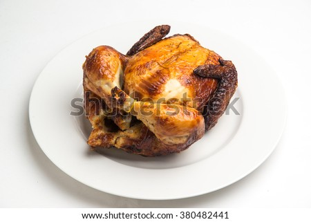 whole cooked chicken with white background - stock photo