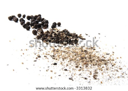 whole, cracked and ground black pepper on white - stock photo