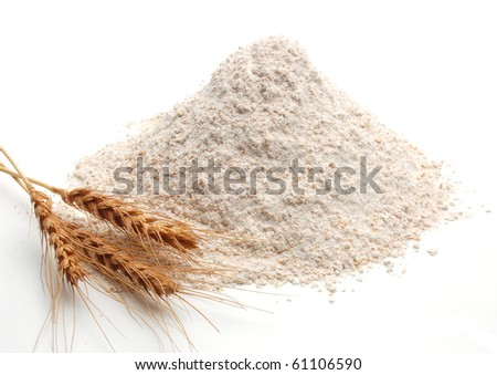 Whole flour and wheat ears on white background - stock photo