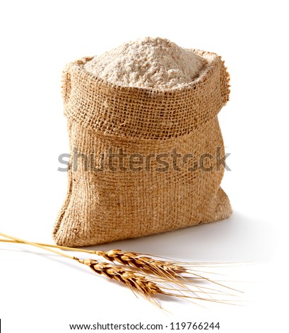 Whole flour in bag with wheat ears