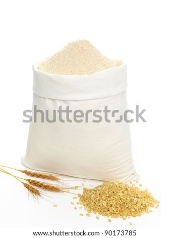 Whole flour in bag with wheat ears on white background - stock photo