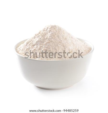Whole flour in bowl on white background - stock photo