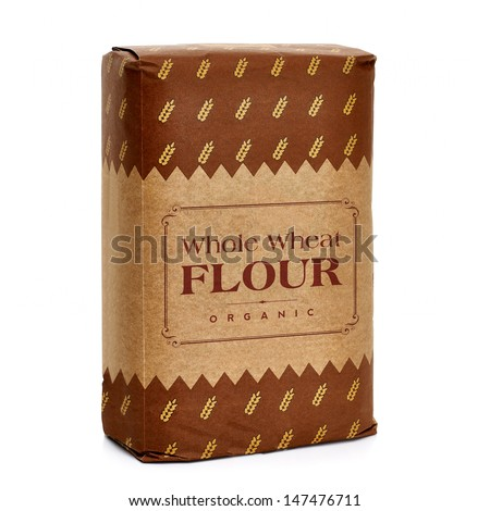 Whole flour in craft paper bag on white background - stock photo