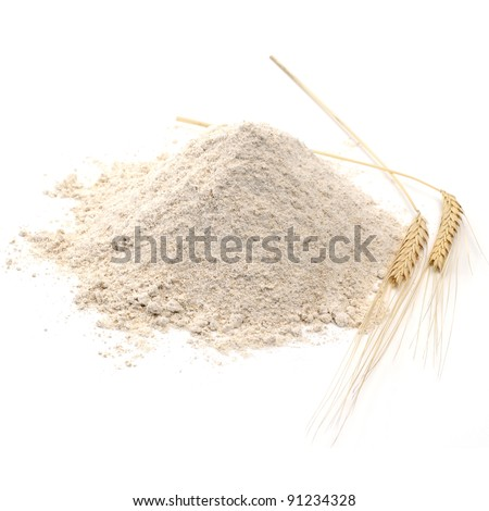 Whole flour pile with wheat ears on white background - stock photo