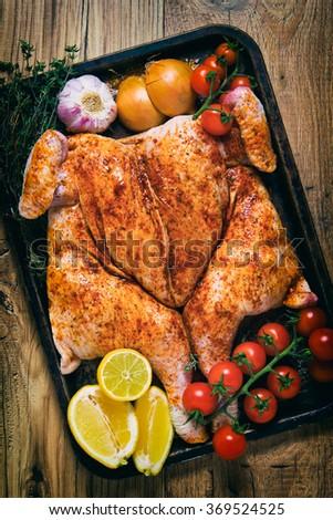 Whole fresh raw spatchcock chicken piri piri  - stock photo