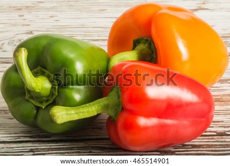 Whole Fresh Ripe Uncooked Red Orange and Green Peppers