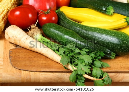 Whole fresh vegetables on wooden board. Bumper crop