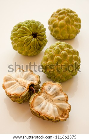 Whole fruit and cross-section, showing creamy white flesh. - stock photo
