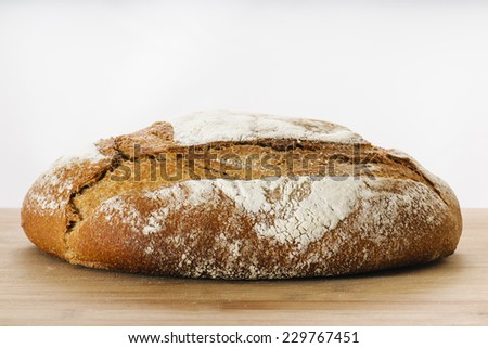 Whole grain Artisan  loaf of bread - stock photo