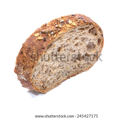 Whole grain bread Slice over white background, diagonal view with shallow focus