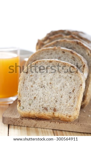 whole grain bread with a glass of orange juice and a cup of hot coffee for morning breakfast. morning breakfast.