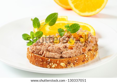 whole grain bread with pate and fresh orange
