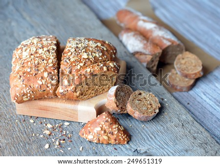 Whole grain bread with sunflower seeds, flax and grain - stock photo