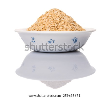 Whole grain breakfast cereal in a white bowl - stock photo