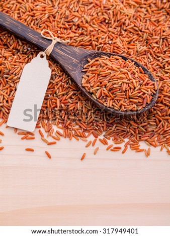 Whole grain Traditional Thai rice best rice for healthy and clean food in coconut wooden spoon . - stock photo