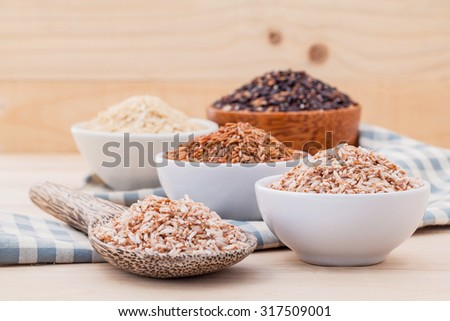 Whole grain Traditional Thai rice best rice for healthy and clean food on wooden background - stock photo