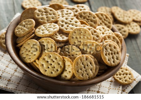 Whole Grain Wheat Round Crackers in a Bowl - stock photo